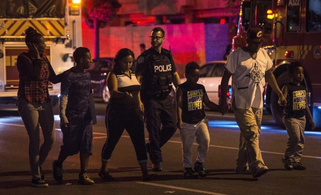 Police escort civilians away from the scene of a shooting in Toronto. (AP/PTI Photo)