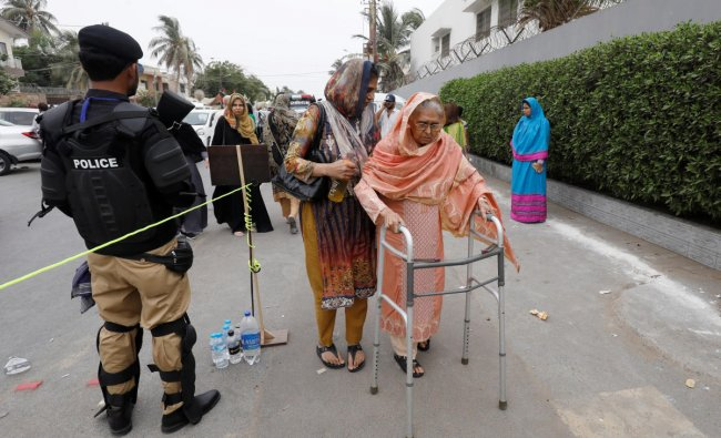 A voter on her way to cast her vote during the general election in Karachi, Pakistan. (Reuters Photo)