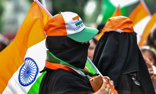Muslim women take part in the Tiranga March (Flag March) on the occasion of the 72nd Independence Day. (PTI Photo)