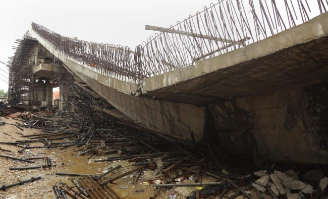 An underconstruction flyover collapses in Basti district. (PTI Photo)