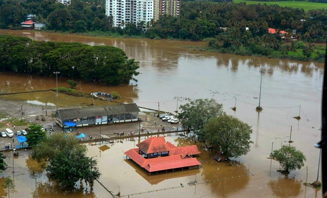 An aerial view of Aluva town following a flash flood after heavy rain, in Kochi on Sunday, August 12, 2018. (PTI Photo)