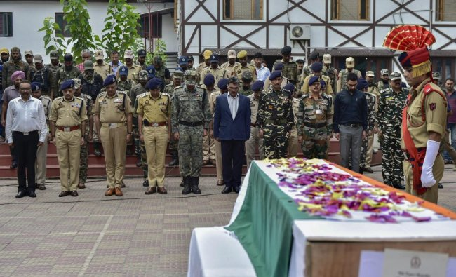 Senior army, CRP, police and civil officers pay tribute to slain SG Constable Parvaiz Ahmad during his wreath-laying ceremony at District Police Lines, in Srinagar, on Sunday, August 12, 2018. According to the officials, Ahmad was killed and five other security forces personnel were injured during an encounter in the Batamaloo area following which two ultras were arrested. (PTI Photo/S Irfan)