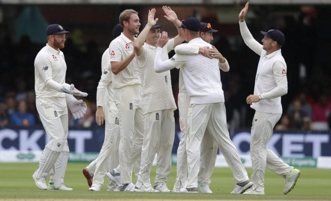 England players celebrate taking the wicket of India\'s Ajinkya Rahane during the fourth day of the second test match between England and India at Lord\'s cricket ground in London, Sunday, Aug. 12, 2018. AP/PTI