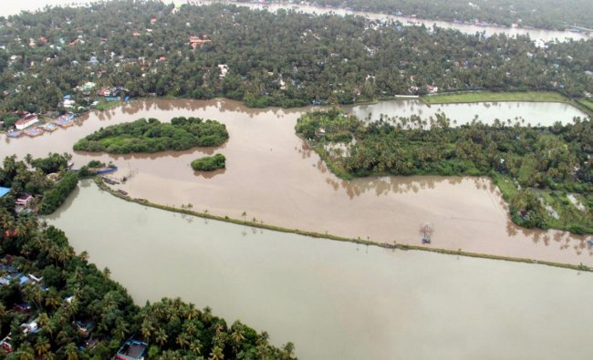 An aerial view of Aluva town following a flash flood after heavy rains, in Kochi on Tuesday 14th Aug 2018. (Navy Photo via PTI)