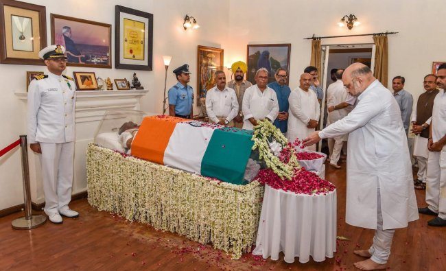 BJP President Amit Shah pays tribute to former prime minister Atal Bihari Vajpayee, at his Krishna Menon Marg residence, in New Delhi on Thursday, Aug 16, 2018. Vajpayee, 93, passed away at AIIMS hospital after a prolonged illness. (PTI Photo/Manvender Vashist)