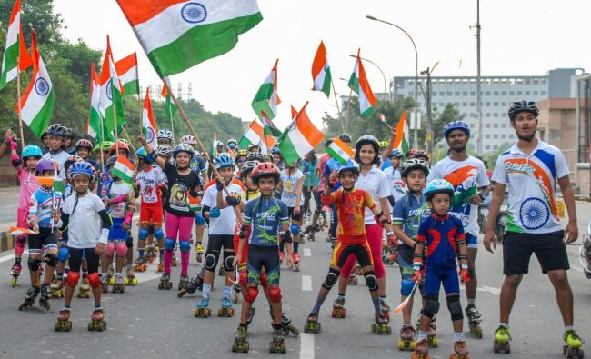 Children, holding tricolours, take part in a skating-rally to celebrate the 72nd Independence Day, in Noida on Wednesday. (PTI Photo)