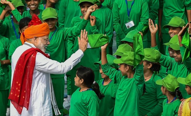 Prime Minister Narendra Modi interacts with children during Independence Day celebrations at the Red Fort, in New Delhi on Wednesday, August 15, 2018. (PTI Photo)