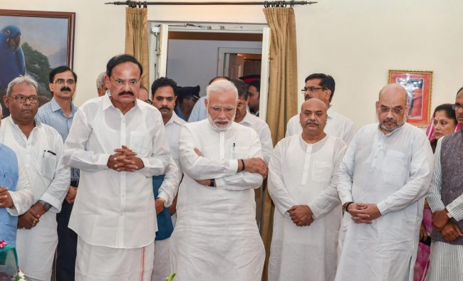 Prime Minister Narendra Modi, Vice President Venkaiah Naidu and BJP President Amit Shah stand with others as they tribute to former prime minister Atal Bihari Vajpayee, at his Krishna Menon Marg residence, in New Delhi on Thursday, Aug 16, 2018. PTI photo