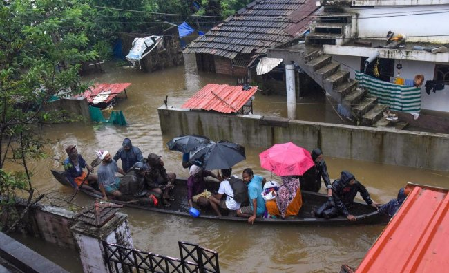 Rescue officials assist villagers out of a flooded area, following heavy monsoon rainfall, near Kochi on Wednesday, Aug 15, 2018. (PTI Photo)