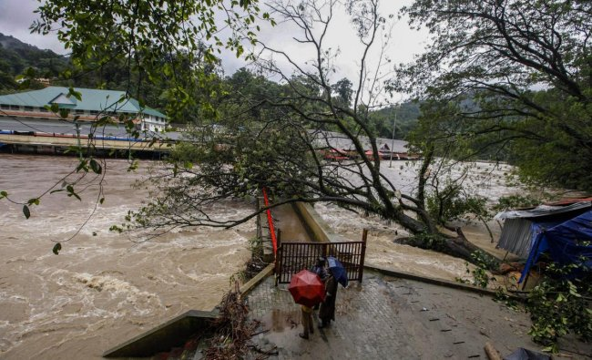 Pampa Manalpuram on the foothills of Sabarimala gets flooded following heavy monsoon rainfall, in Pathanamthitta on Tuesday, Aug 14, 2018. (PTI Photo)