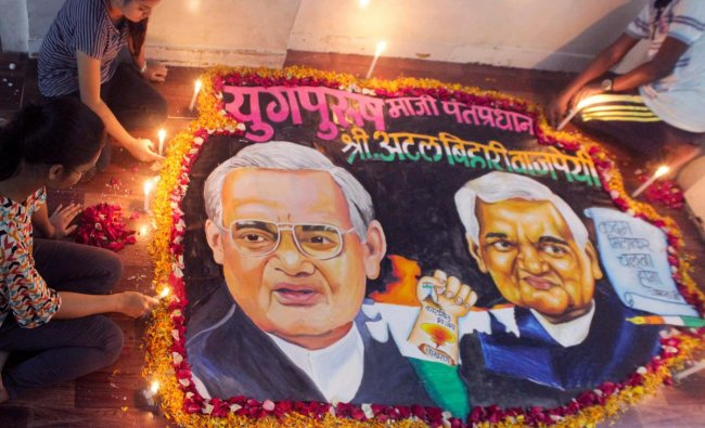 School students prepare a rangoli to pay tribute to former prime minister Atal Bihari Vajpayee, in Mumbai on Thursday, Aug 16, 2018. Vajpayee, 93, passed away at AIIMS hospital after a prolonged illness. (PTI Photo)