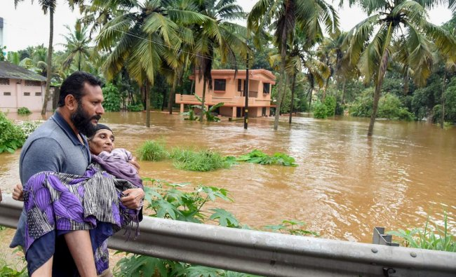 People being rescued from a flood-affected region following heavy monsoon rainfall, in Kochi on Thursday, Aug 16, 2018. (PTI Photo)