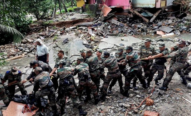 Soldiers clear the debris off a road in a flooded affected area at Wayanad on Saturday, August 11, 2018. (PTI Photo)