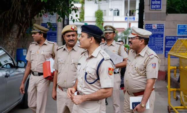 A Delhi Police team headed by Additional DCP (north) Harinder Singh at Patiala House Courts in conncection with Delhi Chief Secretary Anshu Prakash assault case, in New Delhi on Saturday, Au 25, 2018. PTI