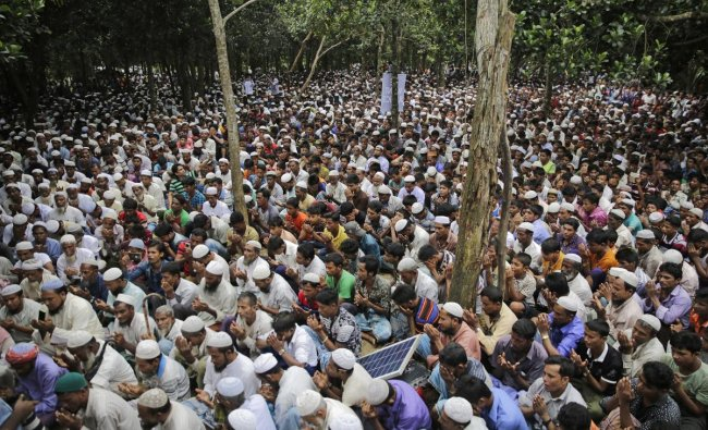 Rohingya refugees pray during a gathering to commemorate the first anniversary of Myanmar army\'s crackdown which lead a mass exodus of Rohingya Muslims to Bangladesh, at Kutupalong refugee camp in Bangladesh, Saturday, Aug. 25, 2018. Thousands of Rohingya Muslim refugees on Saturday marked the one-year anniversary of the attacks that sent them fleeing to safety in Bangladesh, praying they can return to their homes in Myanmar and demanding justice for their dead relatives and neighbors. AP/PTI
