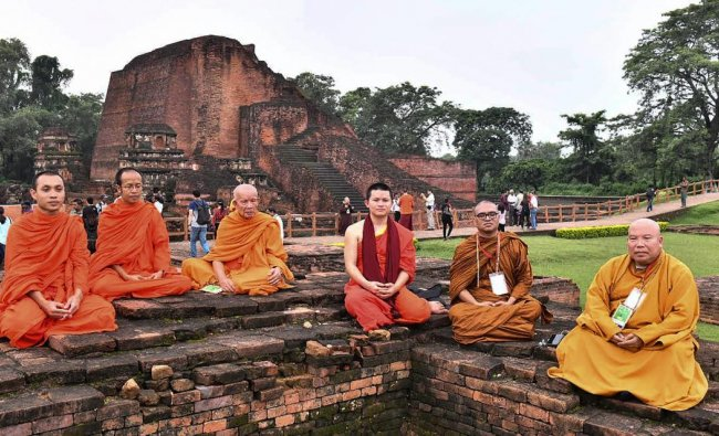 Foreign delegates who have arrived to take part in the International Buddhist Conclave- 2018, visits the ruins of the ancient Nalanda University, in Nalanda, Bihar on Saturday, August 25, 2018. PIB