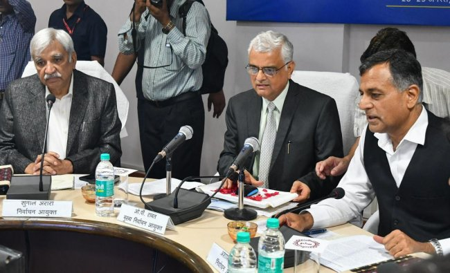Chief Election Commissioner OP Rawat, flanked by Election Commissioners Ashok Lavasa (R) and Sunil Arora, holds a meeting with the district administration officials ahead of the State Assembly elections, in Bhopal on Tuesday, Aug 28, 2018.