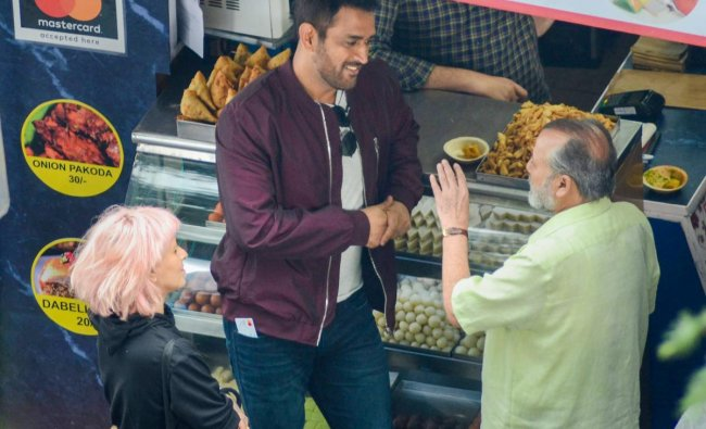 Cricketer M S Dhoni and bollywood actor Pankaj Kapoor during a commercial shoot at Mall Road in Shimla on Tuesday, Aug 28, 2018.