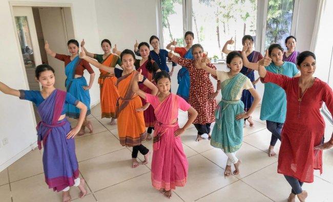 Bharatanatyam exponent Leela Samson (R) teaches dance skills to a group of enthusiasts in Beijing. PTI
