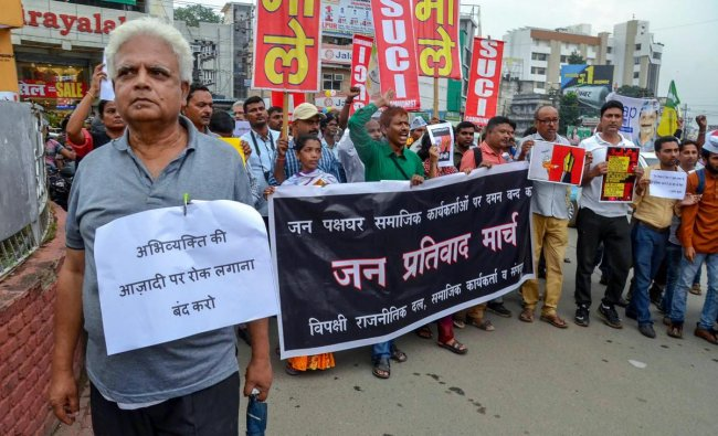 Ranchi: Social activists and filmmakers hold placards during a protest against the raid at activist Stan Swamy\'s residence, in Ranchi on Thursday, Aug 30, 2018. (PTI Photo) (PTI8_30_2018_000202B)