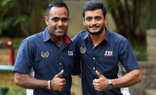 TVS racers Aravind K P (R) and Abdul Wahid Tanveer pose during a press conference regarding their participation in upcoming Pan Africa Moto rally 2018 in Morocco, in Bengaluru on Thursday, Aug 30, 2018. PTI