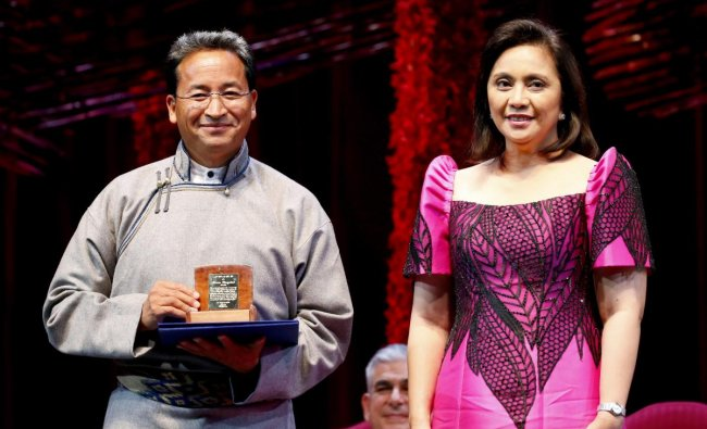 Ramon Magsaysay awardee Sonam Wangchuk, left, from India, holds his award as he pposes with Vice-president Leni Robredo during ceremony at the Cultural Center of the Philippines, Friday, Aug. 31, 2018 in Manila, Philippines. The Magsaysay awards is Asia\'s equivalent to the Nobel Prize and was established in 1958 in honor of the country\'s President Ramon Magsaysay who died in a plane crash. AP/ PTI