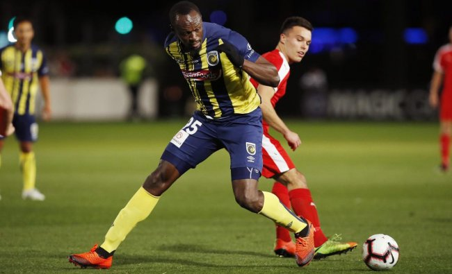 Usain Bolt overruns the ball during a friendly trial match between the Central Coast Mariners and the Central Coast Select in Gosford, Australia, Friday, Aug. 31, 2018. Bolt, who holds the world records for the 100- and 200-meter sprints and is an eight-time Olympic gold medalist, is hoping to earn a contract with the Mariners for the 2018-19 season in Australia\'s top-flight competition. AP/PTI