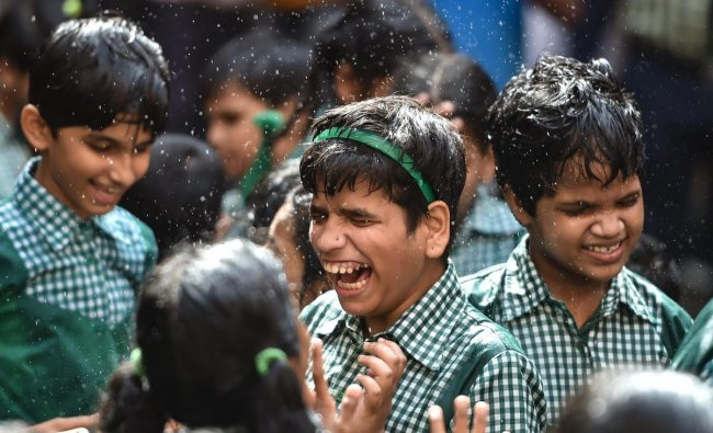 Differently abled children participate in a \'Dahi Handi\' event during Janmashtami celebrations at a school in Mumbai on Friday, August 31, 2018. (PTI Photo /Mitesh Bhuvad)
