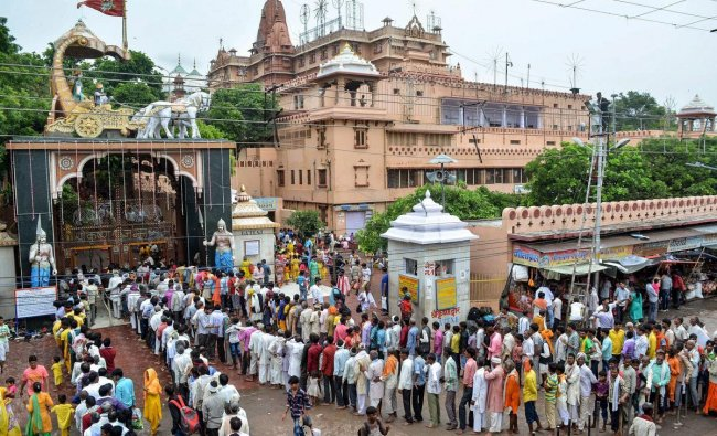 Devotees stand in a queue to offer prayers at Krishna Janamsthan temple on the eve of Janmashtmi festival, in Mathura on Saturday, Sept 1, 2018. (PTI Photo)
