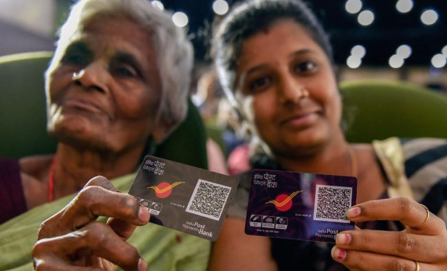 Beneficiaries display their digital QR code at the launch of \'India Post Payments Bank\' (IPPB), in Chennai on Saturday, Sept 1, 2018. (PTI Photo)