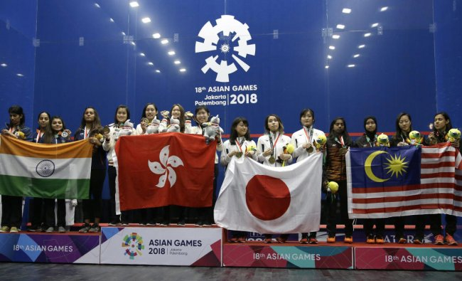 From left to right, team combined India, team Hong Kong, team Japan and team Malaysia stand on the podium during the victory ceremony for women\'s squash competition at the 18th Asian Games in Jakarta, Indonesia, Saturday, Sept. 1, 2018. AP/PTI