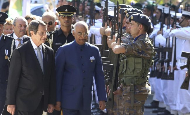 India President Ram Nath Kovind, center, and Cyprus\' President Nicos Anastasiades, left, review a military guard of honor during a welcoming ceremony at the presidential palace in capital Nicosia, Cyprus, Monday, Sept. 3, 2018. India President Ram Nath Kovind is on a two-day visit to Cyprus. AP/PTI