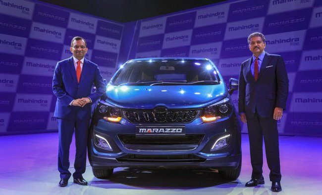 Mahindra & Mahindra Executive Chairperson Anand Mahindra with Managing Director Dr. Pawan Goenka during the launch of Mahindra Marazzo MPV, in Nashik on Monday, Sept 3, 2018. Home-grown auto major Mahindra & Mahindra (M&M) today launched its new utility passenger vehicle Marazzo at a starting price of Rs 9.99 lakh, which will compete with segment leader Toyota Innova Crysta. (PTI Photo)
