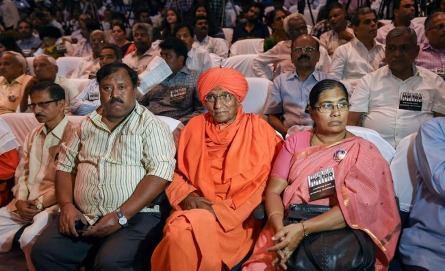 Social activist Swami Agnivesh with others during the \'Freedom of Expression Meet\' organised on the occasion of first death anniversary of journalist Gauri Lankesh, in Bengaluru, Wednesday, Sept 5, 2018. (PTI Photo/Shailendra Bhojak)