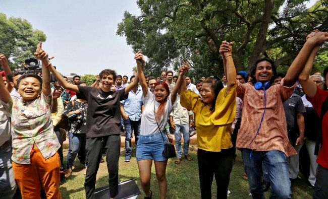 People celebrate after the Supreme Court\'s verdict of decriminalizing gay sex and revocation of the Section 377 law, inside the Supreme Court premises in New Delhi. (Reuters Photo)