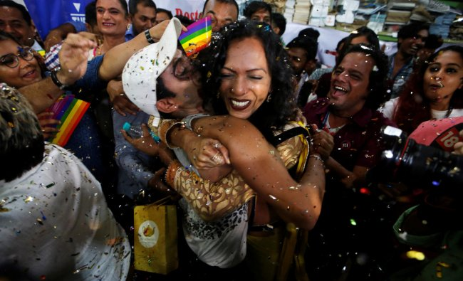 Supporters of the lesbian, gay, bisexual and transgender (LGBT) community celebrate after the Supreme Court\'s verdict of decriminalizing gay sex and revocation of the archaic Section 377 law, at an NGO in Mumbai. (Reuters Photo)