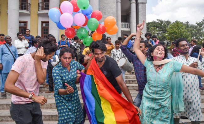 Supporters of the LGBT community celebrate after the Supreme Court\'s verdict of decriminalizing gay sex and revocation of the archaic Section 377 law, in front of Town Hall in Bengaluru. (DH Photo)