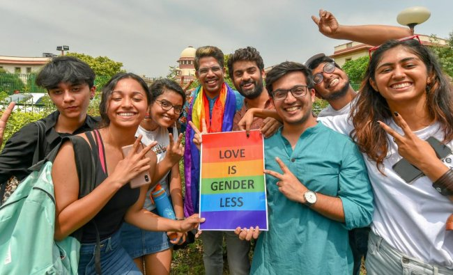 People react after the Supreme Court verdict which decriminalises consensual gay sex, outside the Supreme Court in New Delhi. (PTI Photo)