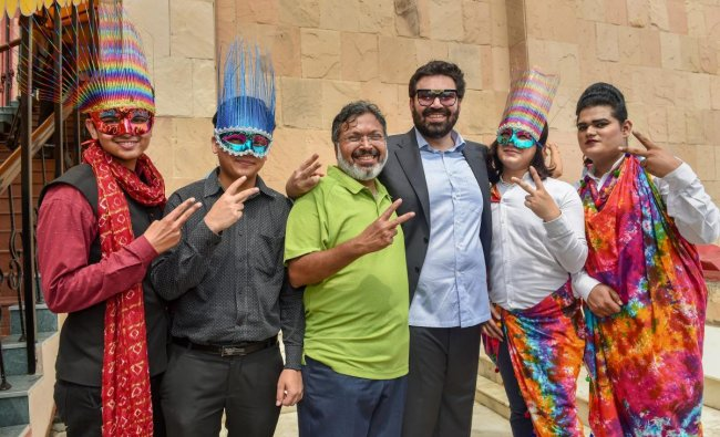 Hotelier Keshav Suri (3rd R), one of the petitioners in the Section 377 case, along with other LGBTQ activists react as they celebrate the Supreme Court verdict that decriminalises the consensual gay sex, in New Delhi. (PTI Photo)