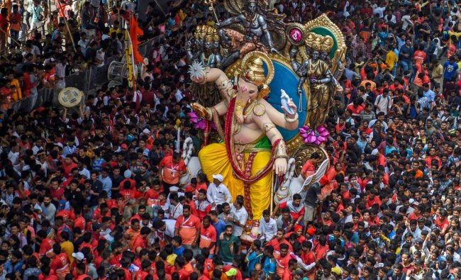 Devotees carry a Ganesha idol to be installed at a pandal ahead of Ganpati festival, in Mumbai on Saturday, Sept 8, 2018. PTI Photo