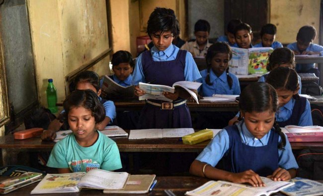 Children attend a class at a Government school on the occasion of \'World Literacy Day\', in Allahabad, Saturday, Sept 8, 2018. (PTI Photo)