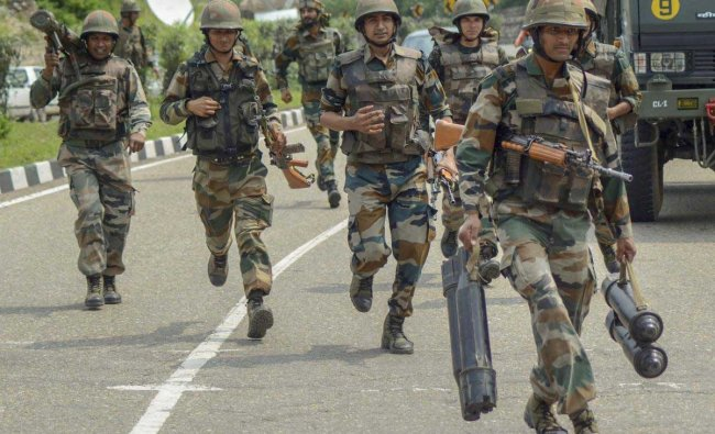 Security personnel cordon off an area during a search operation after militants opened fire at a CRPF post at Jahjar Kotli on Srinagar-Jammu National highway, Wednesday, Sept 12, 2018. (PTI Photo)