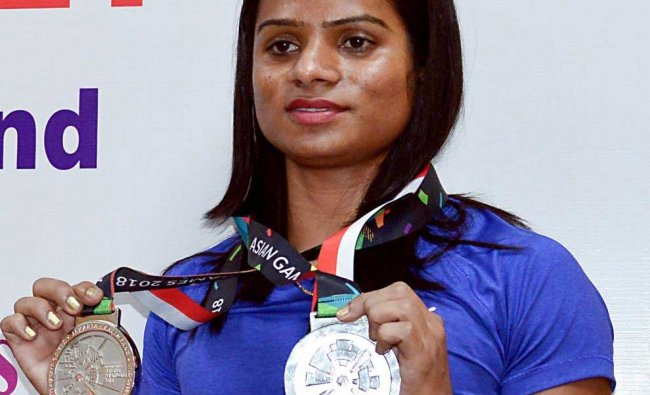 Asian Games winner Indian Athlete Dutee Chand displays her medals during an event, in Bengaluru, Wednesday, Sept 12, 2018. (PTI Photo)