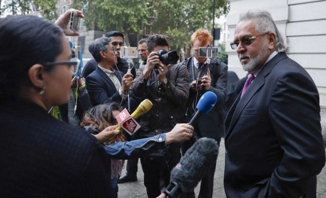F1 Force India team boss Vijay Mallya speaks to the media outside Westminster Magistrates Court during a break for lunch as he attends a hearing at the court in London, Wednesday, Sept. 12, 2018. Investigators have accused the 62-year-old of paying $200,000 to a British firm for displaying his company Kingfisher\'s logo during the Formula One World Championships in London and some European countries in the 1990s. AP/PTI