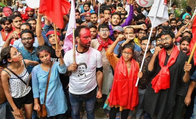Members of Left Unity celebrate after their success in Jawaharlal Nehru University Student Union (JNUSU) elections, in New Delhi, Sunday, Sept 16, 2018. (PTI Photo)