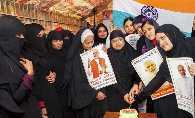 Muslim women celebrate Prime Minister Narendra Modi\'s birthday, in Varanasi, Sunday, Sept 16, 2018.(PTI Photo)