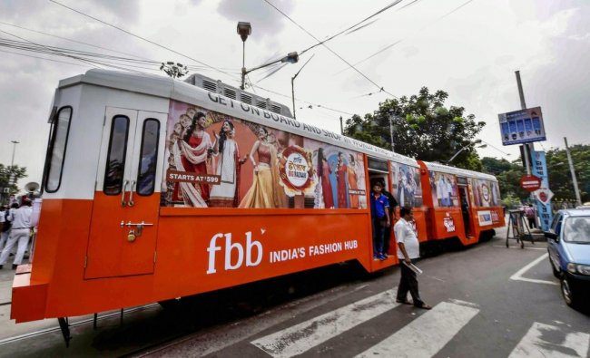 A market organised in a tram for Durga Puja festival, in Kolkata on Wednesday, Sept 19, 2018. (PTI Photo)