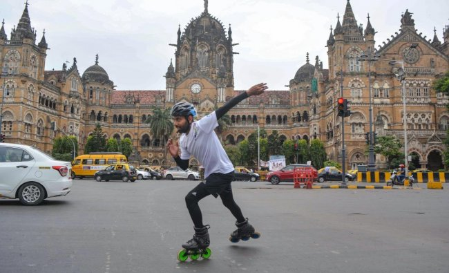 Skater Rana Uppalapati, a 37-year-old businessman from Visakhapatnam who is on a 6,000 km skating trip to educate girls, skates in the backdrop of Chhatrapati Shivaji Maharaj Terminus in Mumbai, Wednesday, Sep 19, 2018. (PTI Photo)