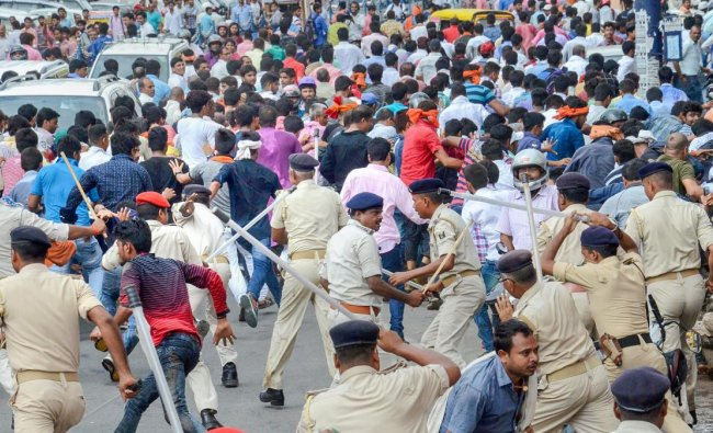 Patna: Akhil Bhartiya Bhumihar Brahmin Mahasabha activists clash with police personnel during their protest over the recent amendment of the SC/ST Act, in Patna, Friday, Sept 21, 2018. (PTI Photo)