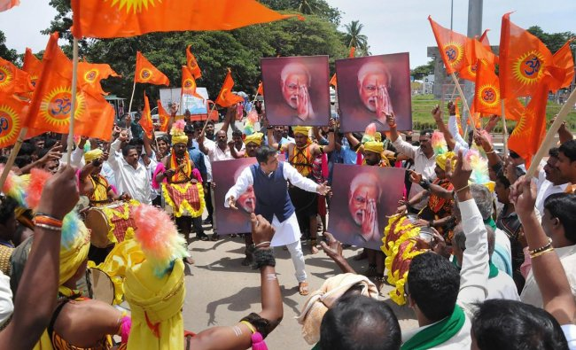 Chikmagalur: Artists perform during the shooting for a song of an album on prime minister Narendra Modi\'s achievements in the past four years, in Chikmagalur, Friday, Sep 21, 2018. (PTI Photo)